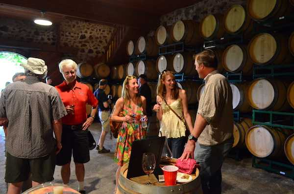 Winery Event and Winemaking Stories: guests cool off in the cellar for barrel tasting