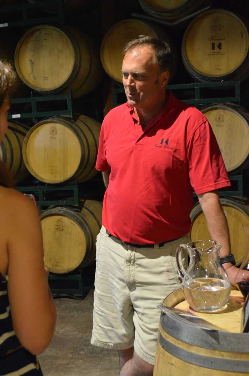 Michael's winemaking stories, chatting with patrons in the barrel room.